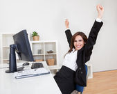 Businesswoman Cheering At Desk — Stock Photo