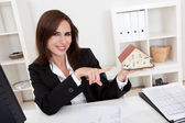 Businesswoman With Home Model — Stock Photo
