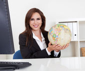 Businesswoman Holding a Globe — Stock Photo