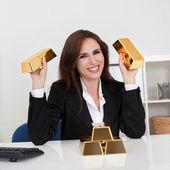 Barra de retención oro empresaria — Foto de Stock