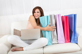 Woman Holding Shopping Bag At Home — Stock Photo