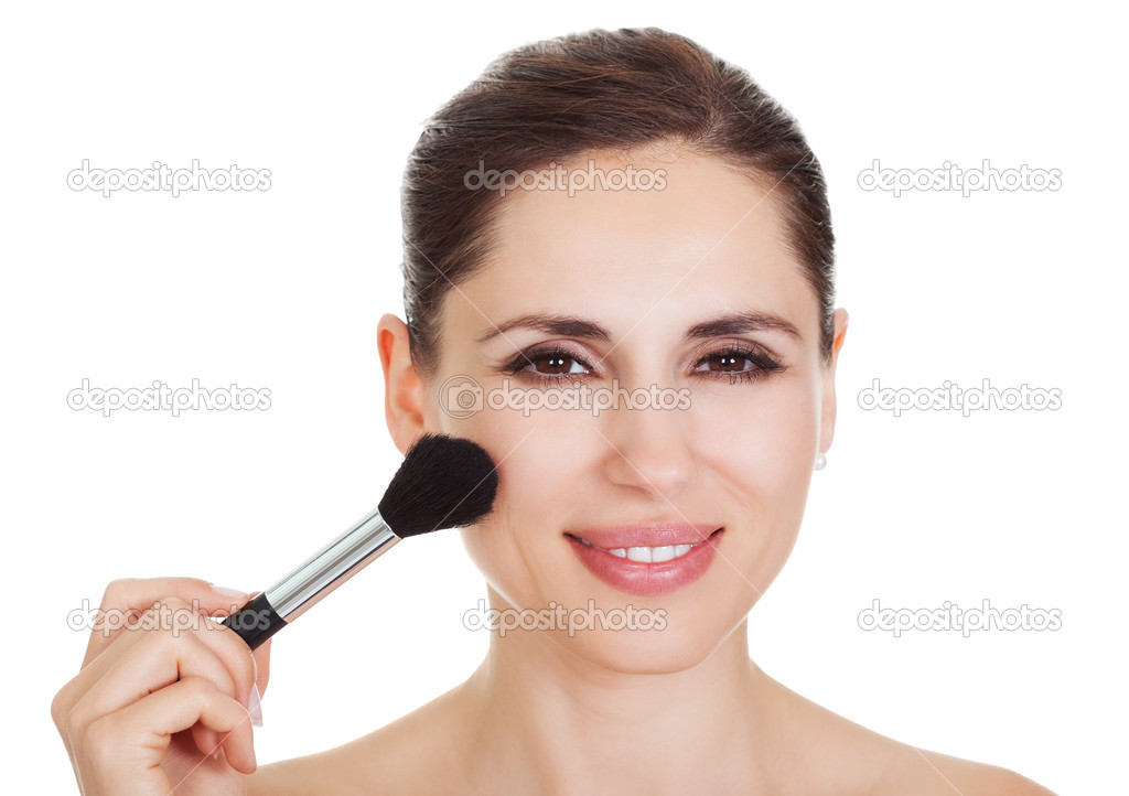 Beautiful woman applying blusher to her cheekbones with a large soft cosmetics brush isolated on white — Stock Photo #12751943