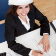 Businesswoman In Hardhat With Blueprints — Stock Photo