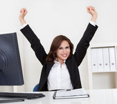 Successful Businesswoman At Desk — Stock Photo