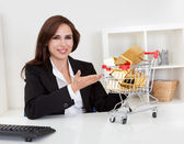 Businesswoman Presenting Gold Bars — Stock Photo