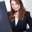 Smiling receptionist or call centre worker — Stock Photo #12777735