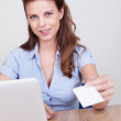 Businesswoman offering her card — Stock Photo #12777795