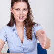 Young woman offering to shake hands — Stock Photo #12777825