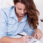 Woman writing in her diary — Stock Photo #12777968