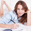 Woman writing in her diary — Stock Photo #12778027