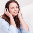 Woman relaxing listening to music — Stock Photo #12778040
