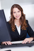 Smiling secretary or personal assistant — Stock Photo