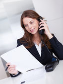 Businesswoman talking on a telephone — Stock Photo