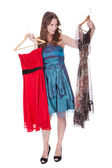 Fashion model with choice of dresses — Stock Photo