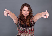Woman pointing with both hands — Stock Photo