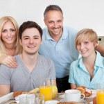 Happy family enjoying breakfast — Stock Photo #12791381