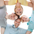 Stock Photo: Happy family looking down