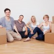 Happy family moving into the new home — Stock Photo