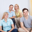 Smiling family in group portrait — Stock Photo #12791621