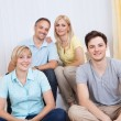 Smiling family in group portrait — Stock Photo