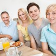 Stock Photo: Happy family enjoying breakfast