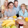 Happy family enjoying breakfast — Stock Photo #12792446