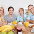Happy family enjoying breakfast — Stock Photo #12792568