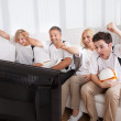 Jubilant family watching television — Stock Photo #12792654