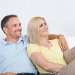 Loving couple relaxing on a sofa — Stock Photo #12792758