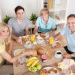 Happy family enjoying breakfast — Stock Photo
