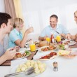 Stock Photo: Family enjoying a meal together