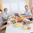 Family eating a cold lunch — Stock Photo #12793621