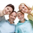 Happy family looking down — Stock Photo
