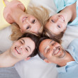 Joyful family with heads together — Stockfoto