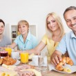 Happy family enjoying breakfast — Stock Photo #12794376