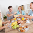 Happy family enjoying breakfast — Stock Photo #12794637