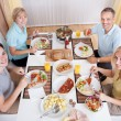 Family eating a lunch at home — Stock Photo #12795076