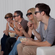 Stock Photo: Family watching 3D television