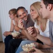 Stock Photo: Family watching television