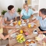 Happy family enjoying breakfast — Stock Photo #12796663