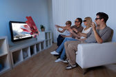 Family watching 3D television — Stock Photo