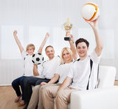 Ecstatic family celebrating a win — Stock Photo