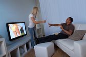 Wife preventing man watching female TV — Stock Photo