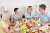 Happy family enjoying breakfast — Stock Photo