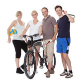 Portrait of a sporting family — Stock Photo