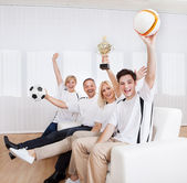 Ecstatic family celebrating a win — Stockfoto