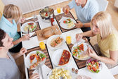 Family eating a lunch at home — Stock Photo