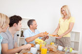 Family served croissants for breakfast — Stock Photo
