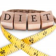 Stock Photo: Alphabet Diet and tape measure