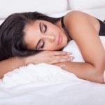 Beautiful woman relaxing in bed — Stock Photo #13138916